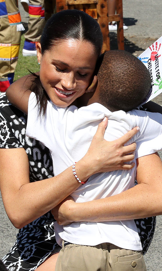 Meghan also gave him a big hug! Aww! 