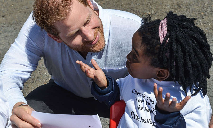 We can only imagine what this little girl was saying to Harry! 