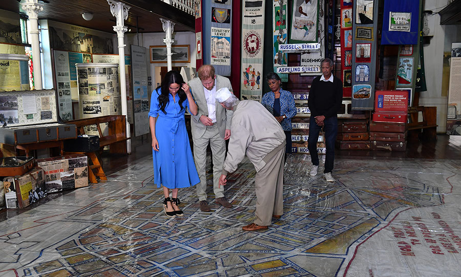 When they were inside the museum, Meghan and Harry were shown a map of District 6, detailing the neighbourhood's history. The Langston Hughes same quote was on the floor. 