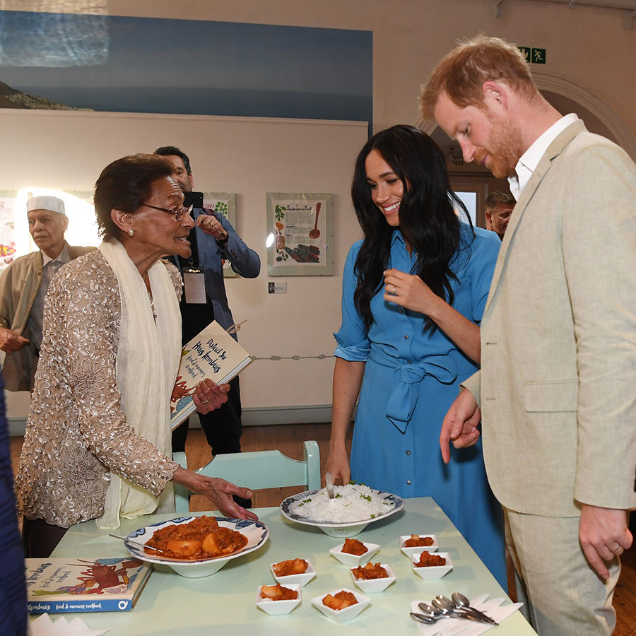Meghan and Harry were invited to sample some residents' cooking. Those who use the Homecoming Centre have put together their own cookbook, similar to the book Meghan assisted with for survivors of the Grenfell Tower fire. Meghan reportedly brought copies of the book to the event and gave them to residents. 
