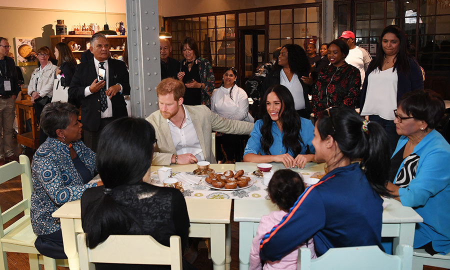 Harry and Meghan then settled in to a table with Bonita and several District 6 residents, enjoying sweets and good conversation.