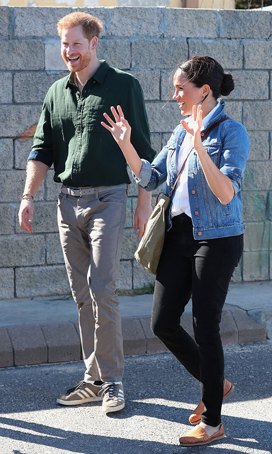 Harry and Meghan looked relaxed and happy as they arrived at the beach, and they were looking very casual, too! Meghan surprised royal watchers by sporting a denim jacket with black jeans and brown loafers. Harry chose a green shirt, grey jeans and Adidas shoes. 