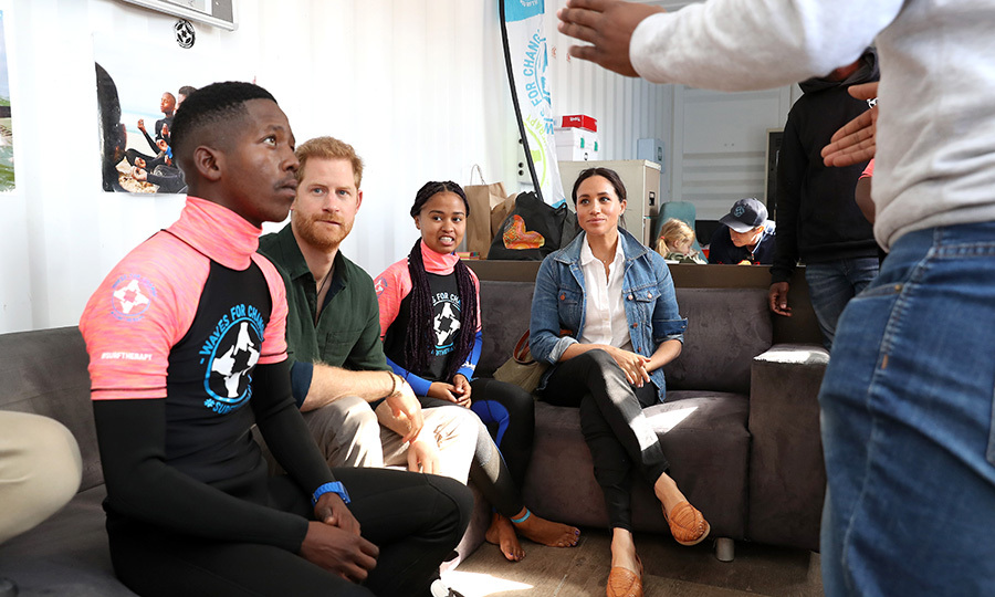 While at the beach, Harry and Meghan took the time to hear about what Waves for Change has been doing to help vulnerable children and youth.