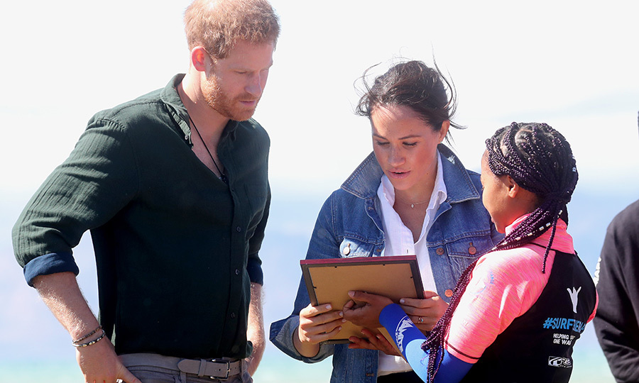 Harry and Meghan were also presented with a special gift from the Waves for Change surf mentors!