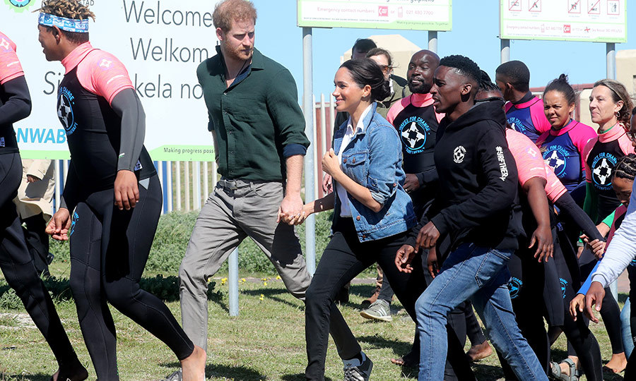 Harry and Meghan held hands again as they walked with the group to do an activity.
