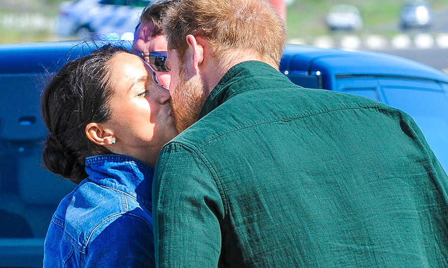 A kiss! The Duke and Duchess of Sussex parted ways so Harry could attend a solo engagement before meeting back up with Meghan later in the afternoon, but before doing so, they said goodbye with their biggest PDA yet on the tour!