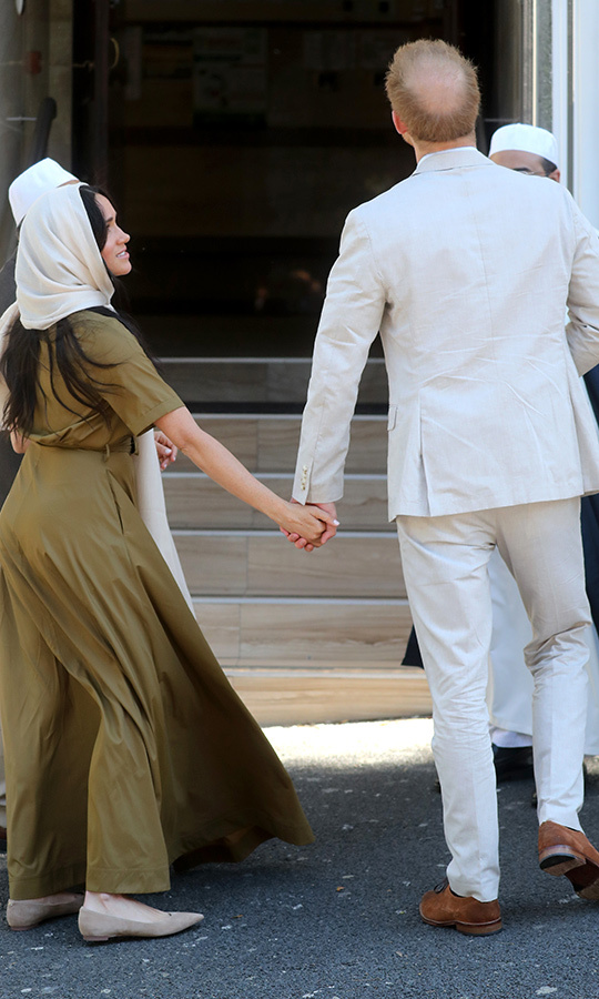 The couple held hands while heading inside. Auwal Mosque symbolizes the freedom of former slaves to worship.