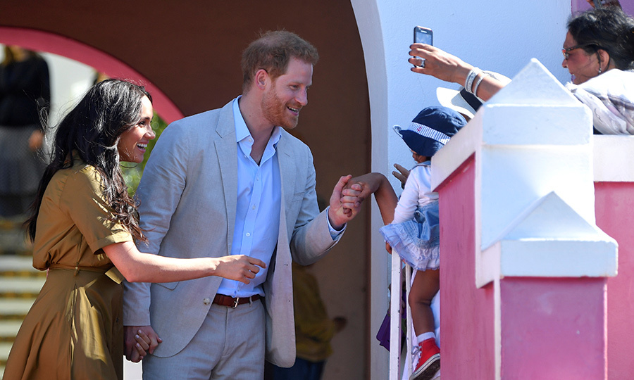 The couple also said hi to an infant while wellwishers were eager to take their photo!