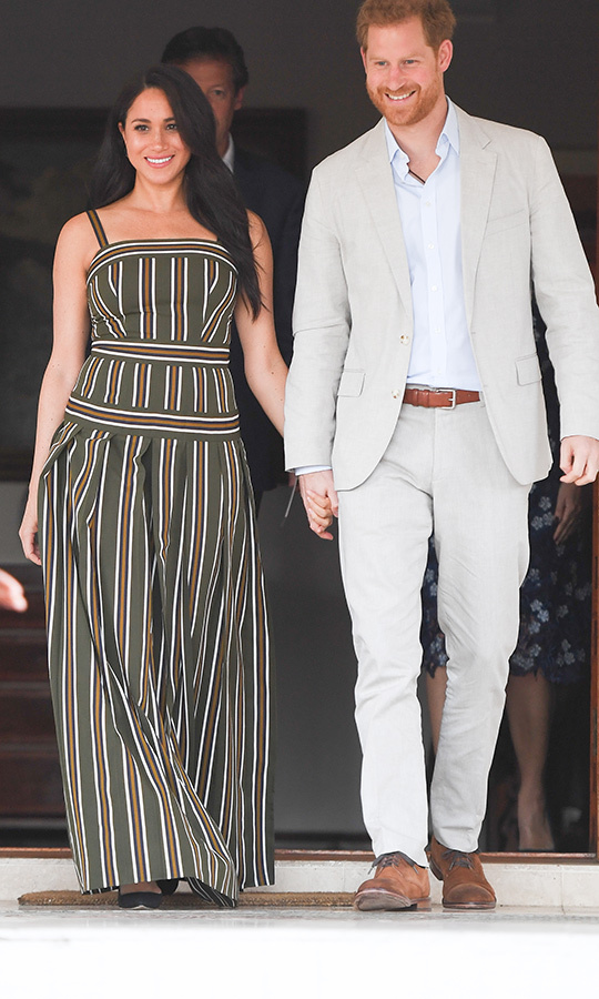 That evening, we saw Meghan in her third outfit of the day! The duchess changed into the Martin Grant maxi dress we saw her wear at Bondi Beach in Australia with Harry in 2018! 