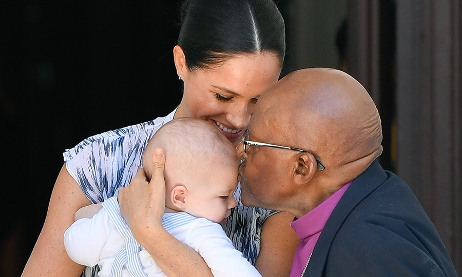 The retired theologian then gave the four-month-old little royal a kiss! 