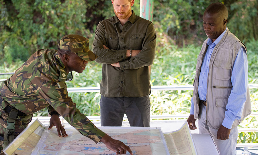 Harry listened to a Botswana Defence Forces soldier involved in an anti-poaching patrol give him details of their work.