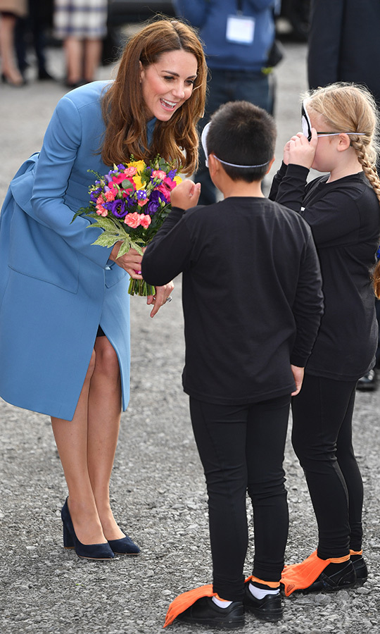 While arriving at the harbour, Kate was given a bouquet by two adorable children dressed as penguins! 