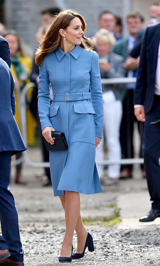 "Before we get to the day's events, we need to talk about Kate's gorgeous coat! The Duchess of Cambridge arrived in a beautiful blue <strong><a href=""/tags/0/alexander-mcqueen"">Alexander McQueen</a></strong> utility coat. 