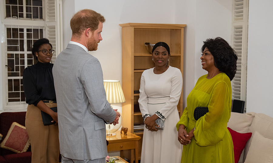 While there, Harry spoke with Angolan First Lady Ana Dias Lourenco (right). 