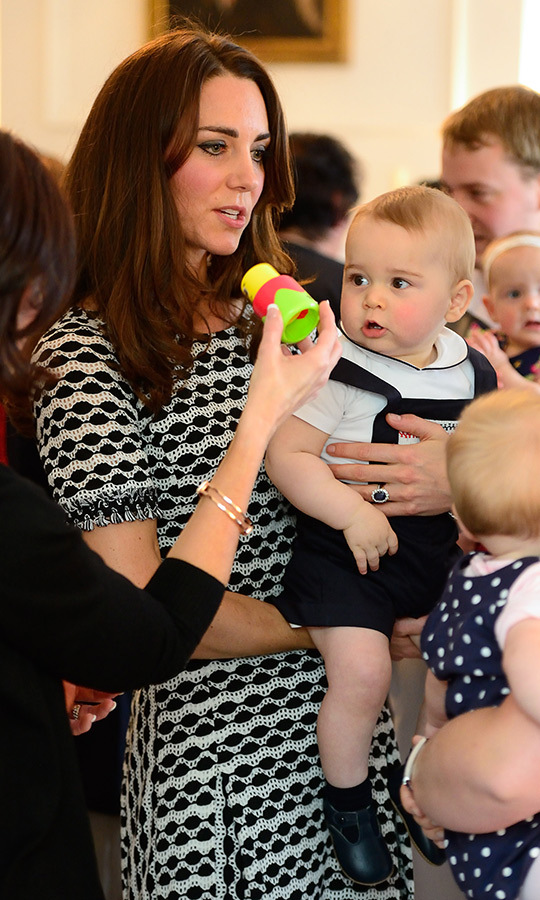 Kate also carried George around at the event while she spoke with other parents. So relatable and cute!