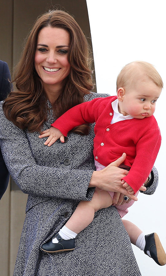 But I don't want to go, mom! George couldn't help but look at the crowd as the Cambridges headed home to the UK on April 25, 2014. 