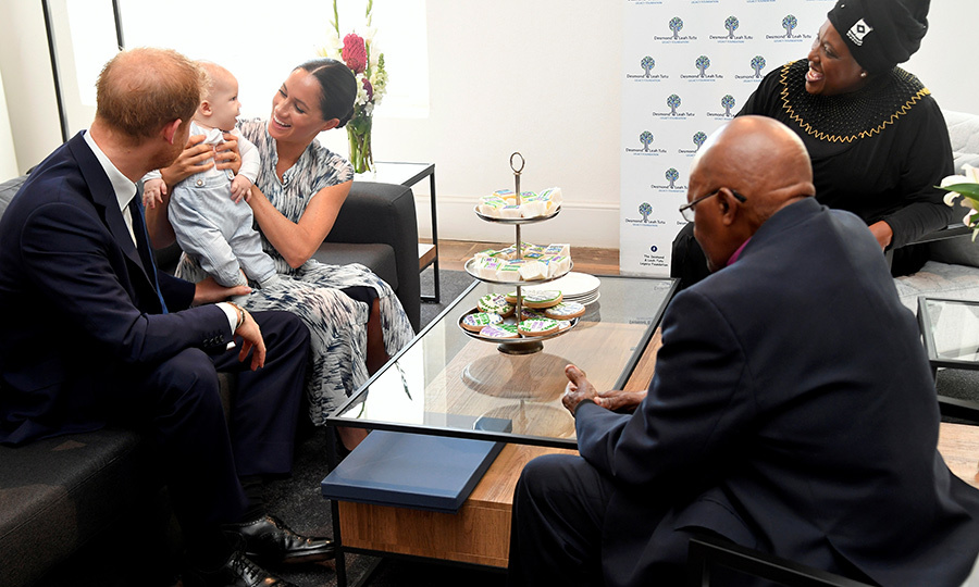 Once inside, Archie sat on Meghan's lap while his parents spoke with Desmond and Thandeka about their charitable work.