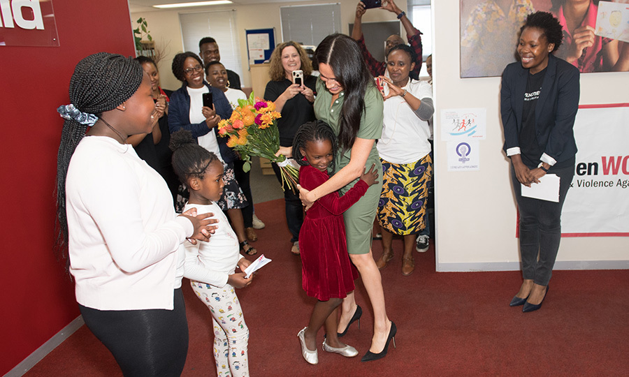Meghan was greeted by some little girls, one of whom gave her some flowers and then a huge hug! 