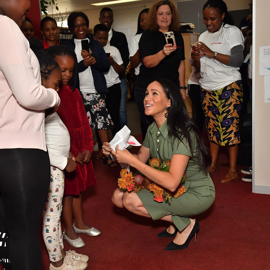 "Another of the little girls, Luyanda, gave the duchess a drawing she had made, which depicted ""love"" and included hearts, clouds and a cross. Meghan was really touched!