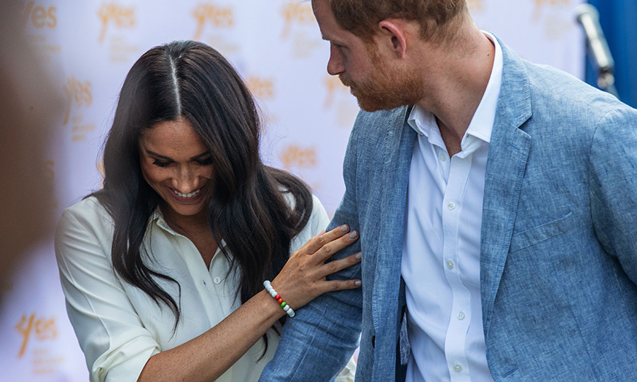At one point, Meghan grabbed Harry's arm in a very adorable way.