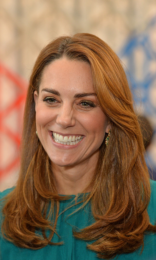 Kate had a huge grin on her face the whole time, and was showing off her new chestnut locks! We bet she can't wait to be on tour! 