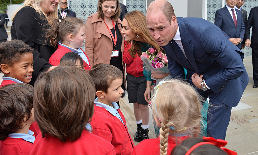 While leaving, William and Kate took some time to say hi to some local schoolchildren, who gave Kate some flowers.