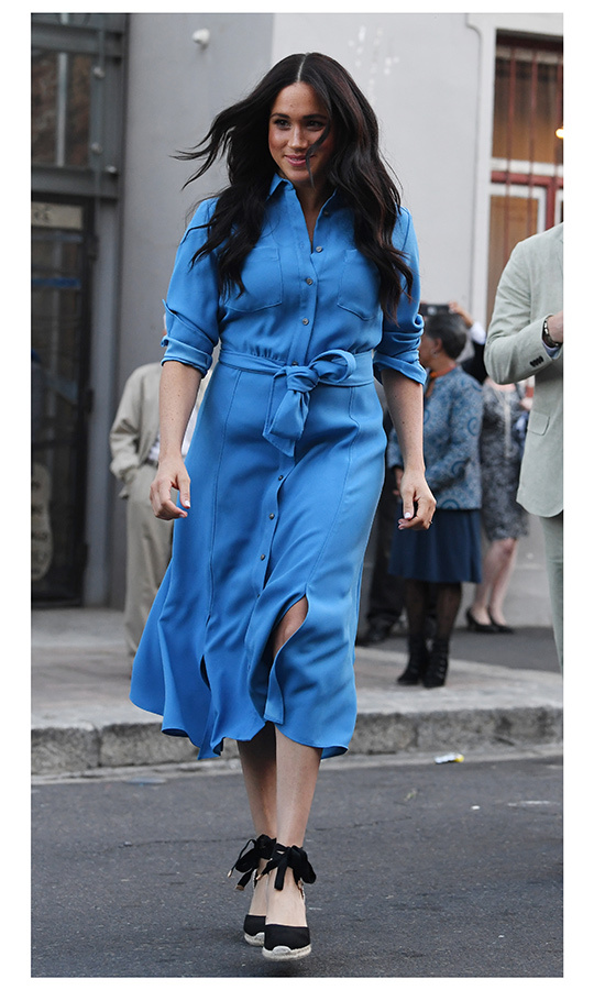 On Sept. 23, Meghan and Harry went straight from the airport to their first two engagements in Cape Town. The duchess arrived at their second event of the day, in which they toured the District 6 Museum and visited its Homecoming Centre, looking beautiful in blue! 