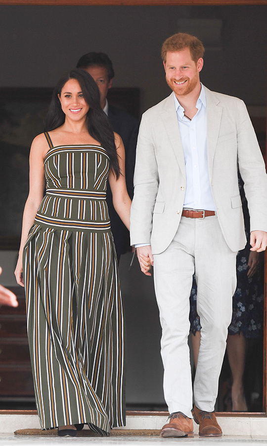 On Sept. 24, Meghan and Harry stepped out to the British High Commissioner's residence in Cape Town to attend a reception. They presented youth volunteers with Commonwealth Points of Light awards for their service. 