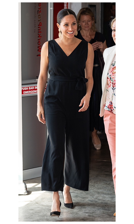"On Sept. 25, Meghan stepped out to Cape Town's Woodstock Exchange wearing a black <strong><a href=""/tags/0/everlane"">Everlane</a></strong> jumpsuit with Manolo Blahnik heels. 