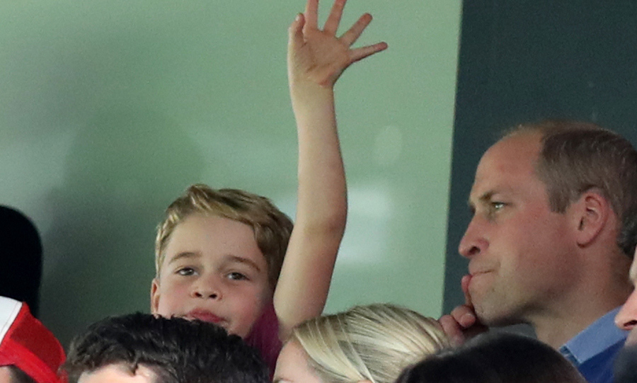 George even gave a little wave at one point. He also got up to cheer when Aston Villa scored a goal!