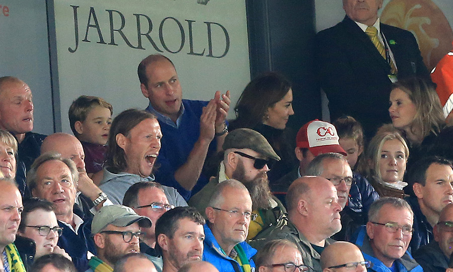Kate was spotted talking to a friend while William and George intensely watched the game.