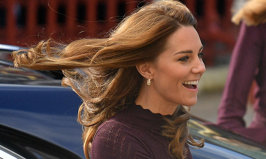 As she said hello, the wind caught Kate's gorgeous hair, to which she's recently added chestnut highlights. It blew it back a bit, giving us a great look at the <Strong>Asprey Woodland Collection Oak Leaf</strong> hoop earrings.