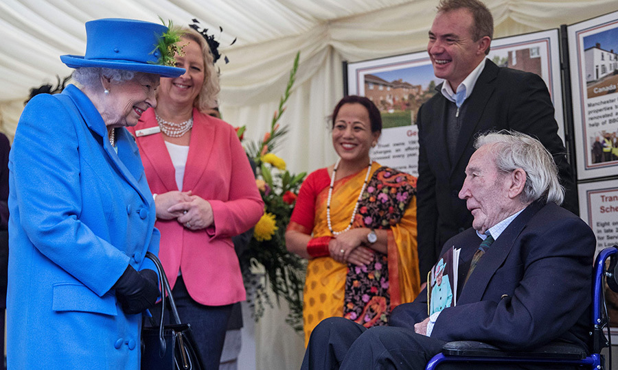 "The Queen also met with veterans – one of them, <strong>Ken Souter</strong> (pictured seated in the wheelchair), just turned 100 and fought in World War II. When someone turns 100, they get a special birthday card from Her Majesty, who told Ken she was happy to see his card arrived ""on time."" What a joker! 