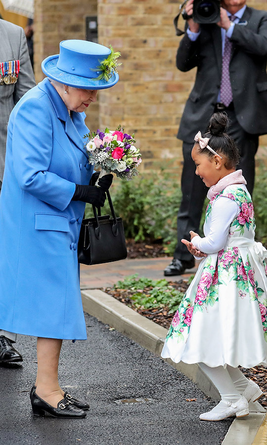 Upon arrival at the Haig Housing Trust, she was handed a multicoloured bouquet by this adorable little girl, who gave her the cutest curtsy. Both looked very pleased to meet each other!