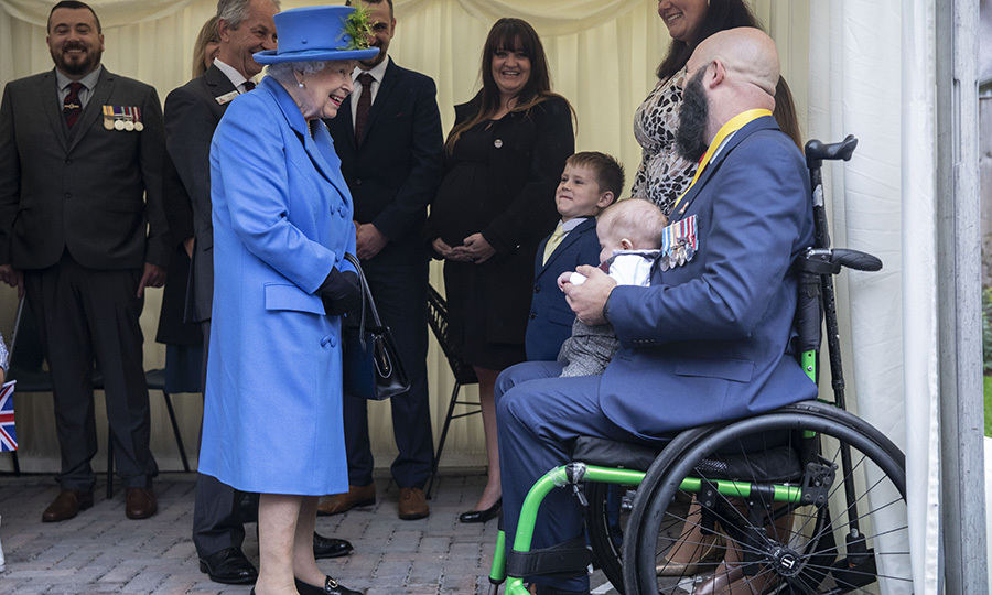 She also took some time to talk to this veteran, with his newborn baby. 