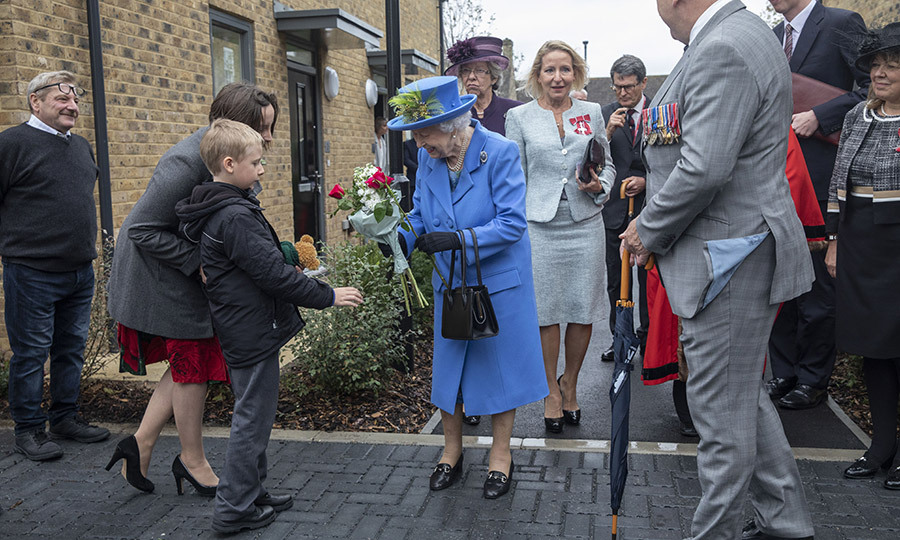 This adorable little boy gave Her Majesty another bouquet as she was leaving.