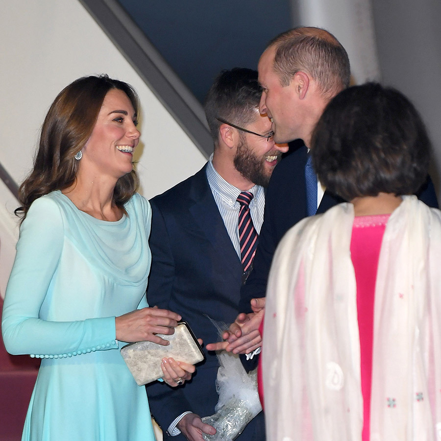 It was a long flight from London, and the couple looked happy to be starting their tour, laughing with each other as they descended the staircase.