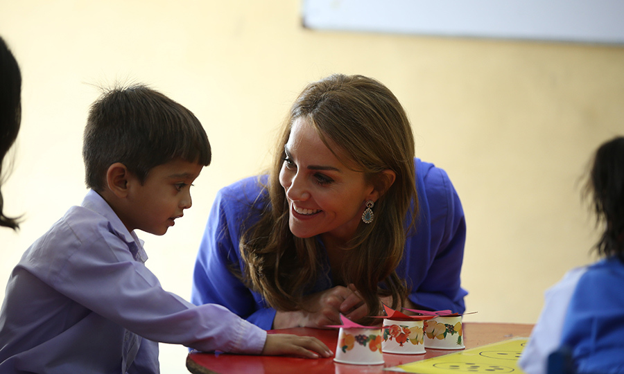 They then spent time with the kids, who showed them their artwork. Kate was especially attentive to these two little angels! 