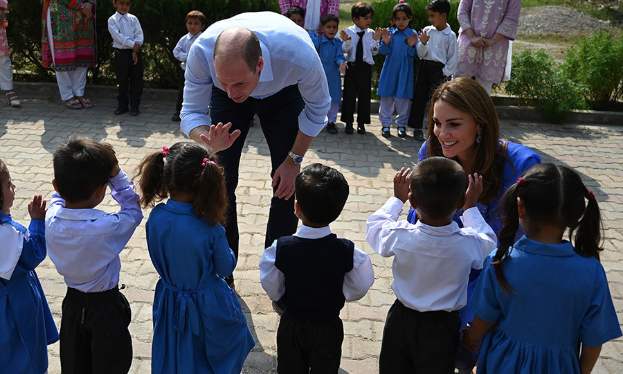 William and Kate were very keen to speak to the students when they arrived. The duke was doling out plenty of high-fives and the duchess was right down at eye level to say hello to all the children!