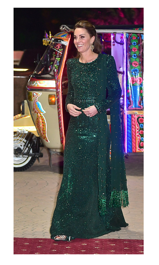 "Kate looked incredible in a shimmering emerald green <strong><a href=""/tags/0/jenny-packham"">Jenny Packham</a></strong> and scarf that made her look like the true jewel she is!