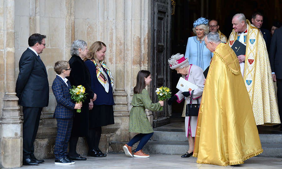 The Queen received a bouquet from a youngster after the service, which she graciously accepted. 