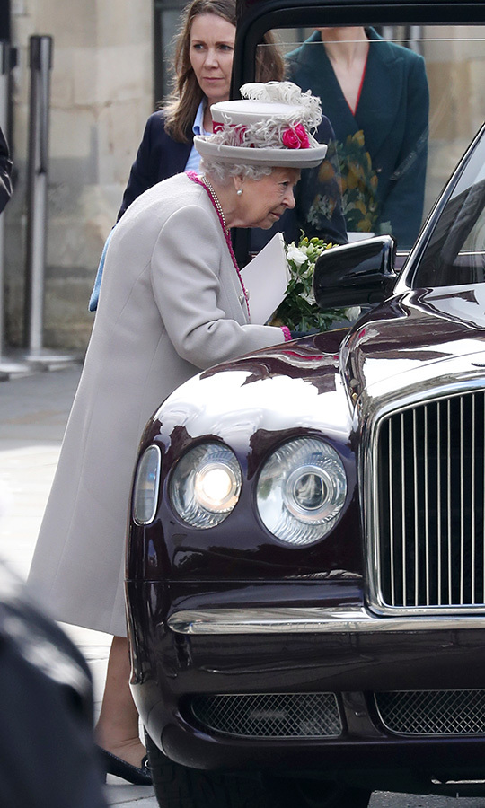 Looking happy, Her Majesty got in.