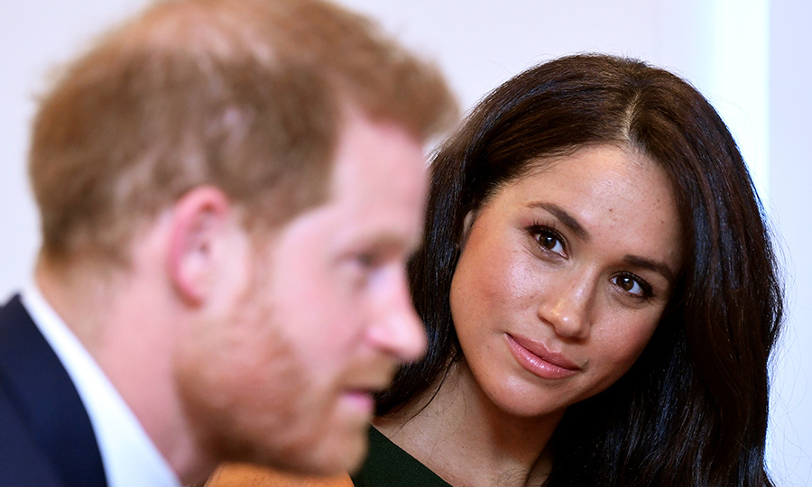 Meghan looked lovingly at her husband while the two spoke to award recipients. 