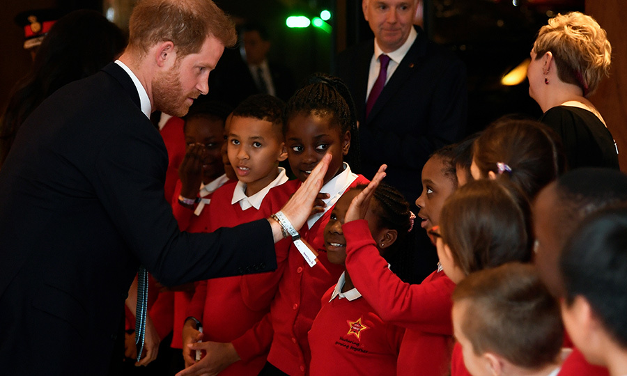 Harry was happy to give the choir all high fives!