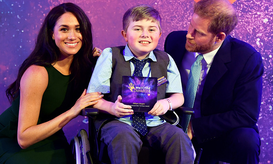 Meghan joined him for a picture with winner William Magee.