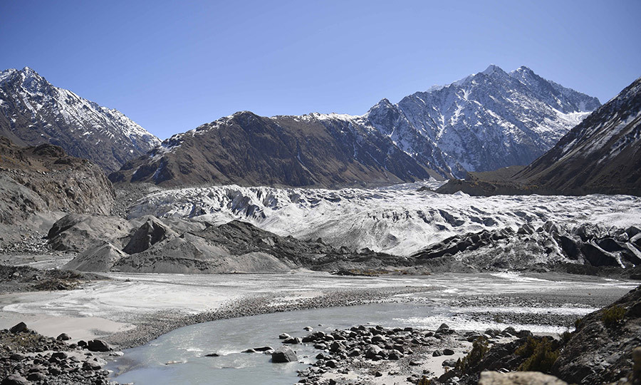 The couple were taken by a helicopter up to the glacier's northern tip, so they could see how the important ecological feature in the Hindu Kush mountains is retreating due to climate change. 