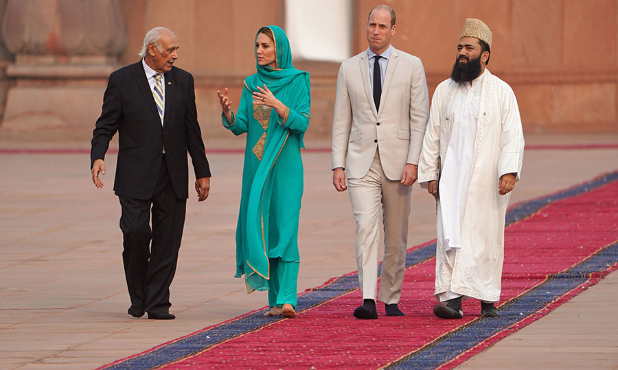The couple were accompanied by Imam <strong>Maulana Abdul Khabeer</strong> (right) and another staff member (left). 