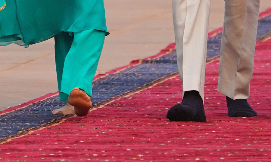 The couple were in stocking feet as a sign of respect.