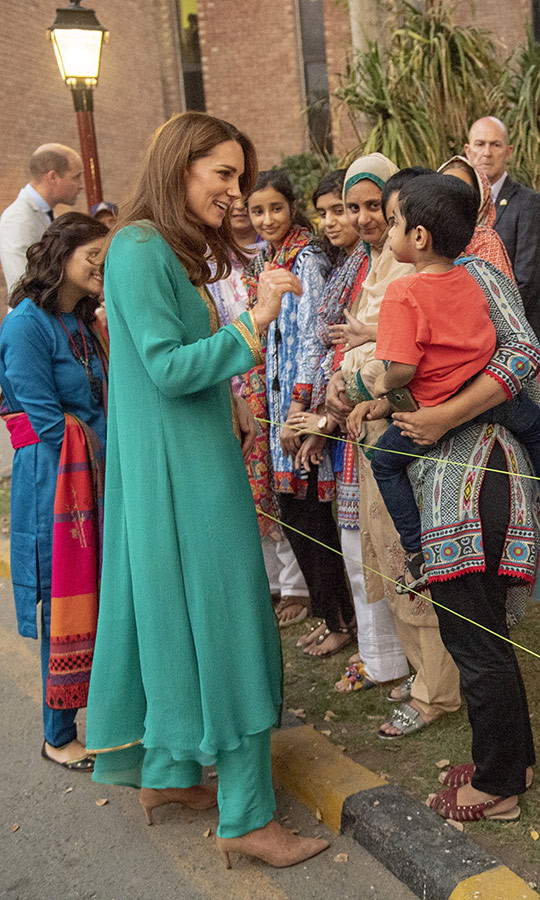 "Kate and William then headed to the Shaukat Khanum Memorial Cancer Centre & Hospital, opened by Pakistani PM <strong>Imran Khan</strong> in 1996. <Strong><a href=""/tags/0/princess-diana"">Princess Diana</a></strong> previously visited the centre and helped fundraise for it during <a href=""https://ca.hellomagazine.com/royalty/02019101653397/princess-diana-visits-to-pakistan""><strong>two trips</a></strong> in 1996 and 1997. Kate bonded with some children outside. 