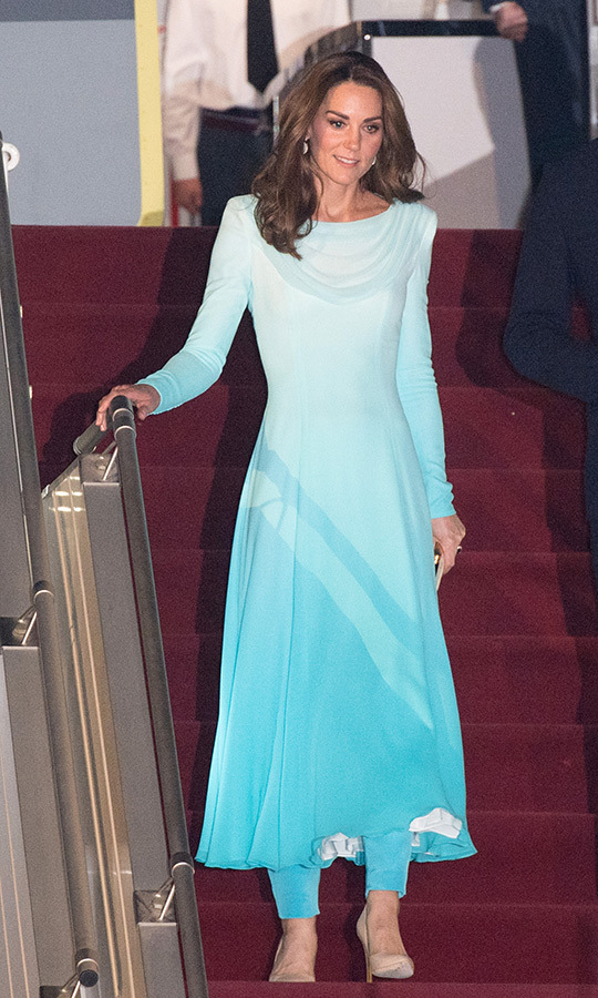 "Duchess Kate was stunning from the second she landed in Pakistan! The always elegant royal stepped off her flight in Rawalpindi looking like a dream! She was clad in a bespoke ombre turquoise <strong><a href=""/tags/0/catherine-walker"">Catherine Walker</a></strong> look inspired by the shalwar kameez - a traditional outfit consisting of a dress overtop of trousers. On her feet, Kate wore nude <strong><a href=""/tags/0/rupert-sanderson"">Rupert Sanderson</a></strong> pumps.